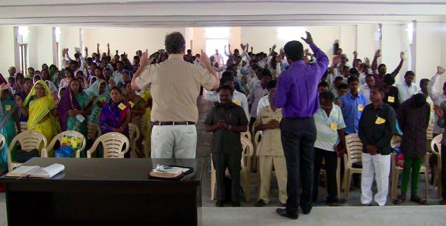 Tom praying with pastors about their calling at Karimnagar.